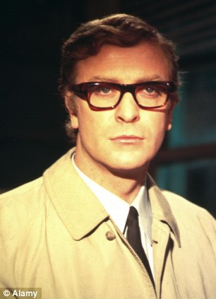 Reynolds was considered the inspiration for Michael Caine's 1965 depiction of fictional spy Harry Palmer (above) in the film The Ipcress File