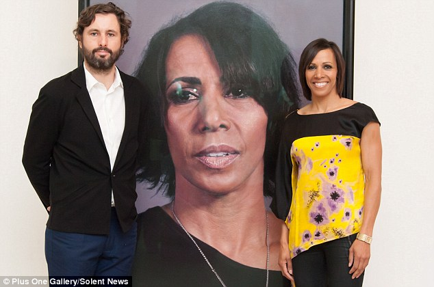 Life-like: Mr Wylie has painted a portrait of double gold Olympic medallist Dame Kelly Holmes. They are pictured together in front of the painting