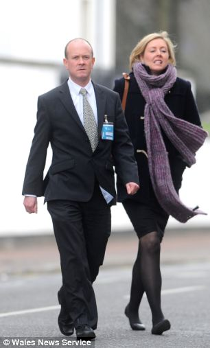 Pc Mike Baillon and his wife at the tribunal