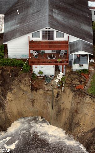 On the edge: A home in Lake City, Florida had a very close call in 2005 (left) and