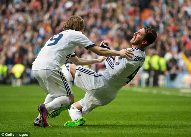 Joy unconfined: Ramos celebrates with Luka Modric, who swung in the corner for the winning goal