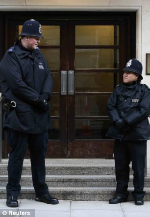Big protection: PC Wallyn and a colleague outside the hospital last night