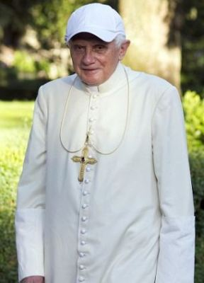 Sun hat: The pope seen in an official picture in 2010 in the gardens of his summer residence