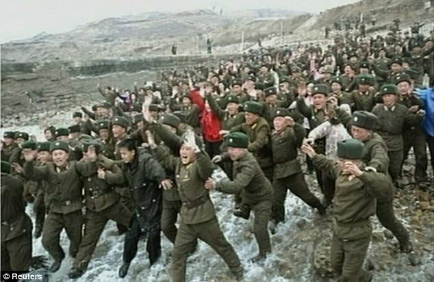 Adulation: North Korean soldiers cheer at the arrival of Kim Jong Un on a visit to their base