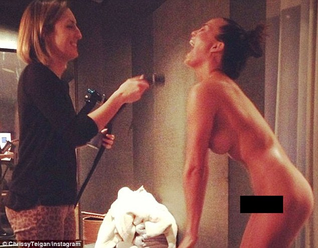 Rude and nude: Model Chrissy Teigen tweeted a photo of herself in the buff getting a spray tan
