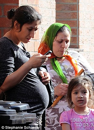 Hopes: Roma woman Maria Marin (in headscarf) who would like to come to the UK next year