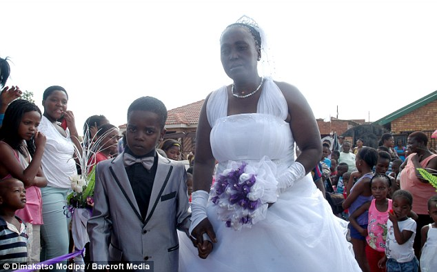 Eight-Year Old Sanele Masilela walks down the aisle with his 61-year-old bride Helen Shabangu at their wedding ceremony in Tshwane, South Africa