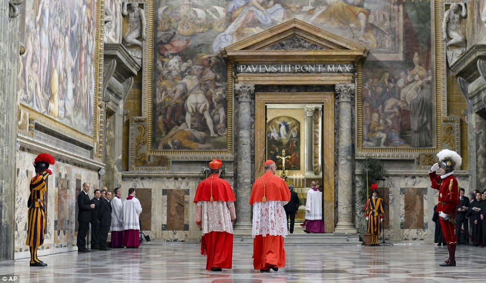 On their way: Cardinals Giovanni Lajolo and Tarcisio Bertone entering the Sistine Chapel to begin the conclave on Wednesday