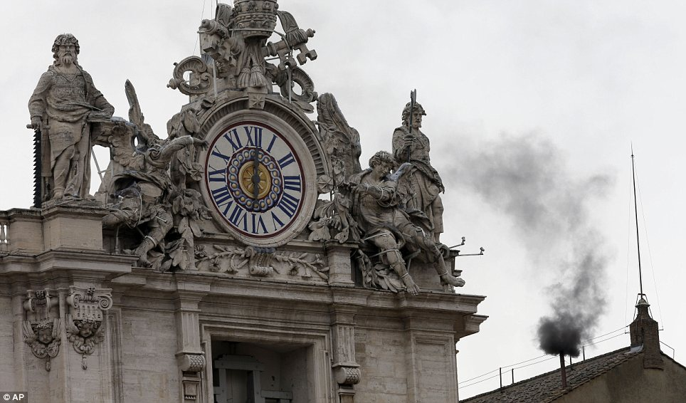 No result: Smoke rose over the roofs of the Vatican to indicate that the Pope had not yet been chosen this morning