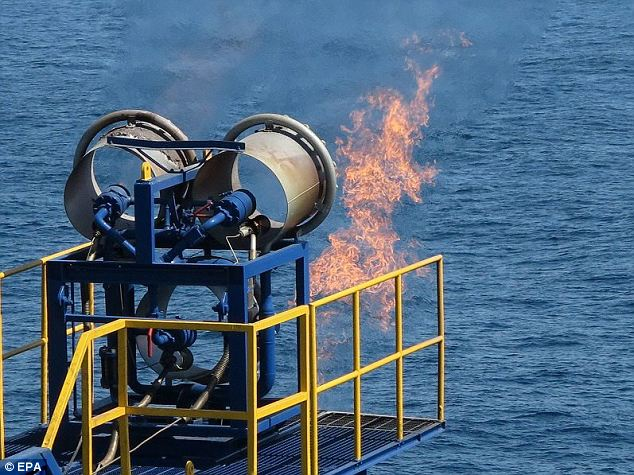 Gas flames expelled from a burner on the Chikyu: Methane hydrate, a sherbet-like substance buried beneath continental shelves around the world, has been tipped by energy experts to be the next major energy resource