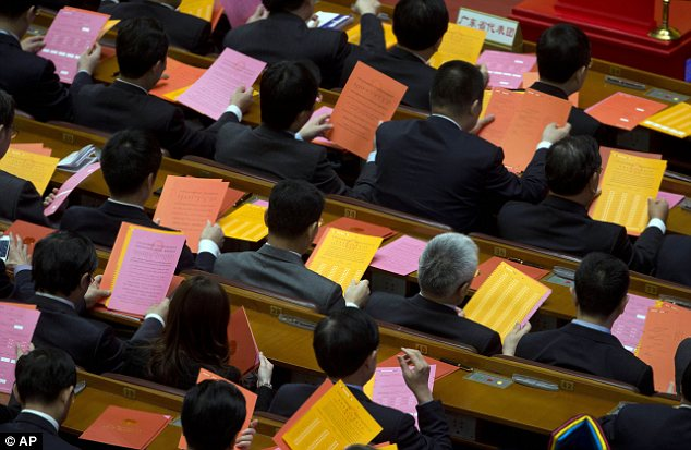 Voting: Delegates examine their ballot papers, an unusual sight in the undemocratic state