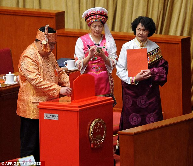 Standing out: Ethnic minorities are invited to the congress in large numbers to emphasise China's diversity