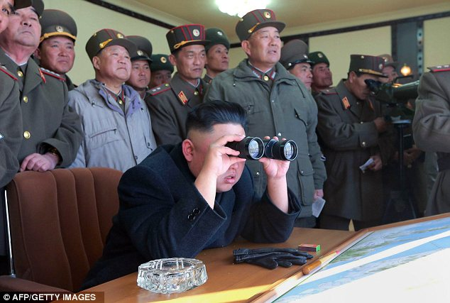 Supervising: North Korea's latest drill was overseen by dictator Kim Jong Un, pictured with his generals