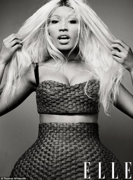 Dangerous curves ahead: Nicki displays her famous figure in an arty black and white shot in which she wears a woven raffia bustier and matching skirt