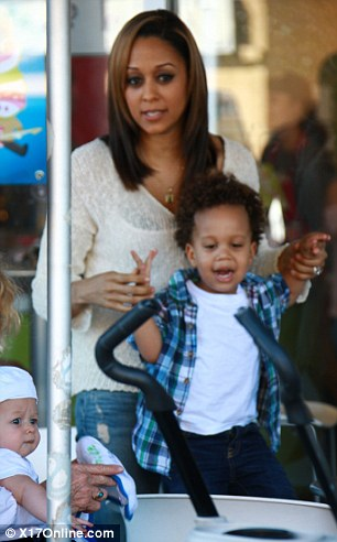 Twins Tia and Tamara Mowry buy frozen yoghurt for sons Cree and Aden while filming their reality