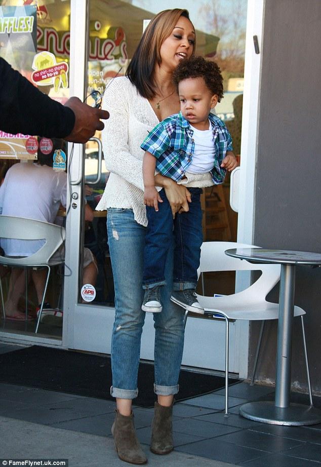 Twins Tia and Tamara Mowry buy frozen yoghurt for sons