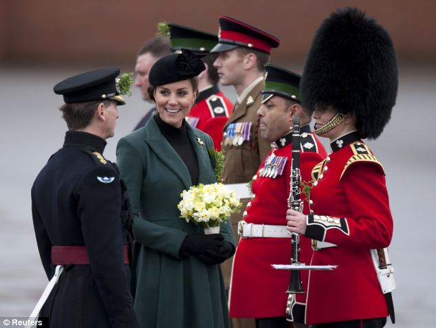 Meet and greet: The Duchess of Cambridge was given bunch of flowers during the visit to the barracks