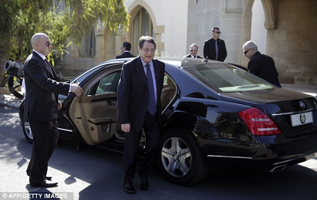 Under pressure: Cyprus President Nicos Anastasiades arrives at the presidential palace in today