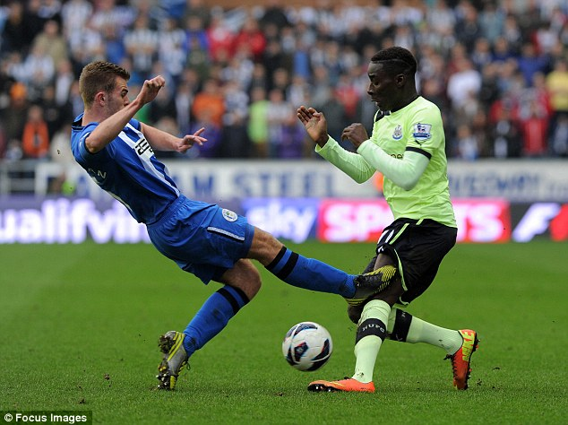Wigan's Callum McManaman tackles Newcastle's Massadio Haïdara