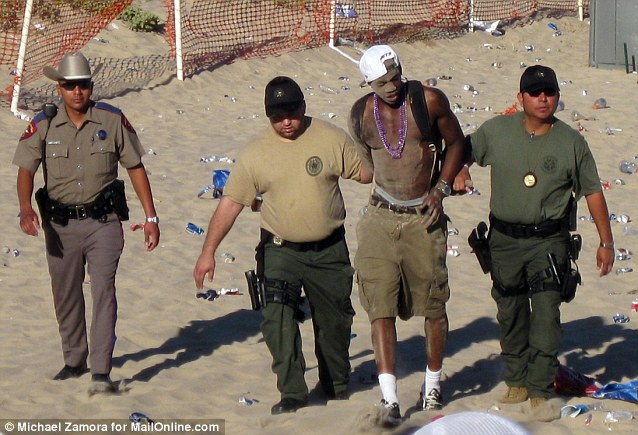 A party goer is taken into police custody. There were over 400 felonies during last year's spring break