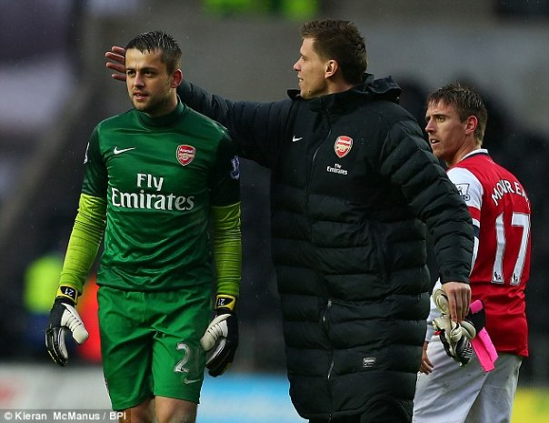 Goalkeepers' Union: Szczesny congratulates Lukasz Fabianski at the end of the 2-0 win at Swansea on Saturday