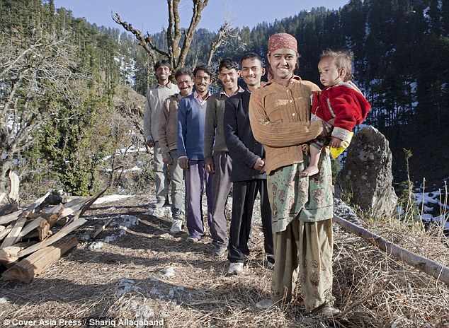 Happy family: Five brothers (L-R) Sant Ram Verma, 28, Bajju Verma, 32, Gopal Verma, 26, Guddu Verma, 21, and Dinesh Verma, 19, with their shared wife Rajo Verma, 20, and their son Jay Verma