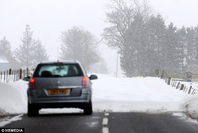 No-go area: A motorist is unable to continue on a snow-covered road near Forfar in Angus, Scotland