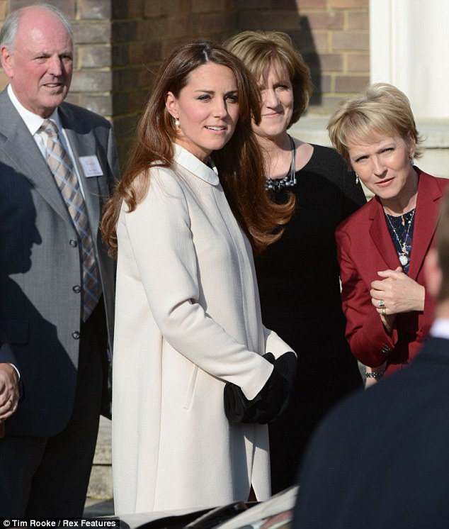 Kate abandoned her usual belted style of coat for a collarless cream wool design from Goat that was a little roomier around the waist