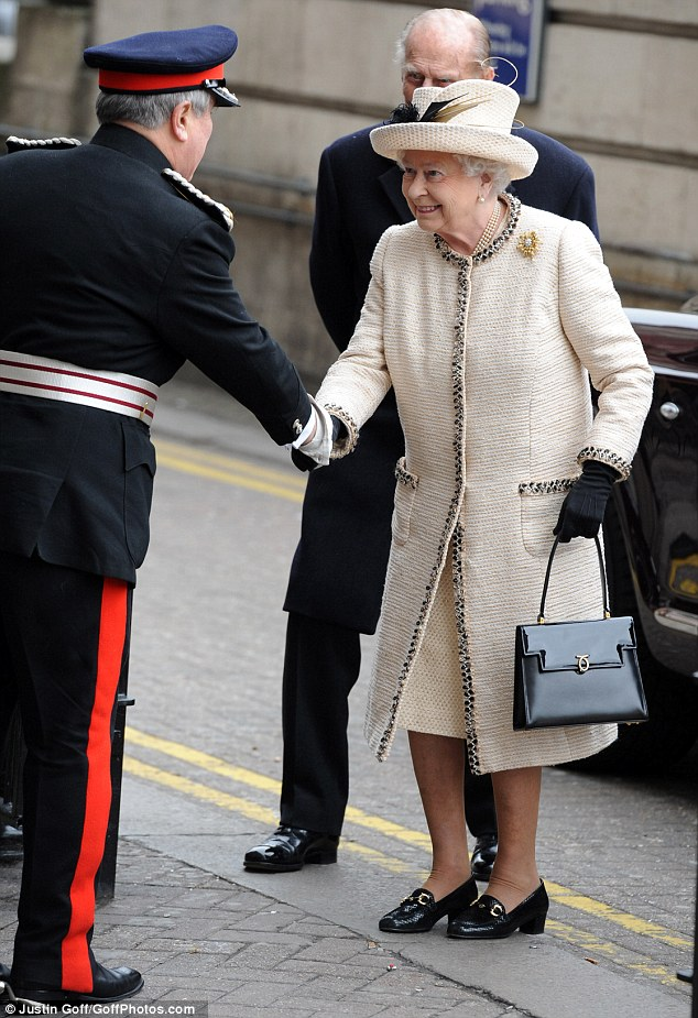 Back to her best: The Queen and the Duke of Edinburgh visit Baker Street tube station to celebrate the 150th anniversary