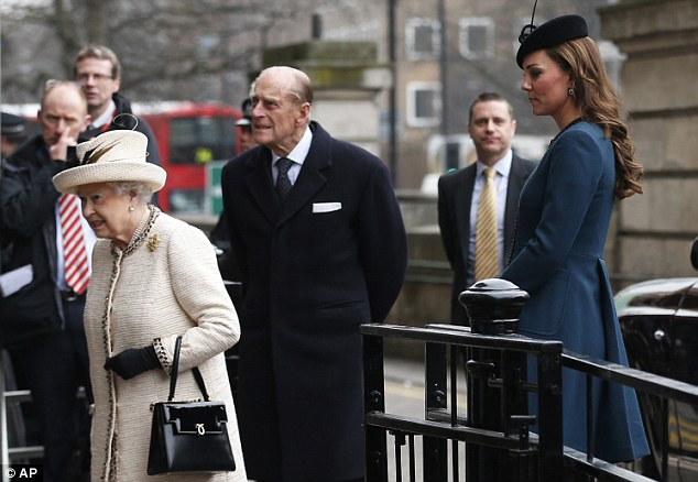 Family outing: The Duchess of Cambridge, right, follows Queen Elizabeth II, left, and Prince Philip, center, as they arrive at Baker Street underground station