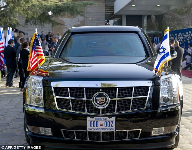 American made: The car that President Obama drove off in after speaking at President Peres' house was definitely an incarnation of 'The Beast' given it's Washington DC license plates and 5-inch-thick doors