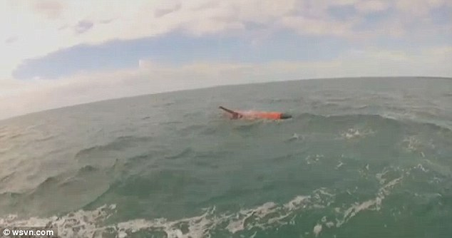 Floating: The 20-foot-long orange drone was spotted by boaters off the Florida Keys over the weekend