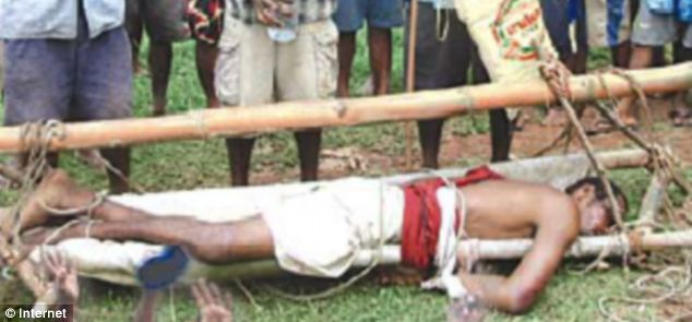 Capture: The feared Tari was beaten by villagers and tied up before being handed over to the police in 2007