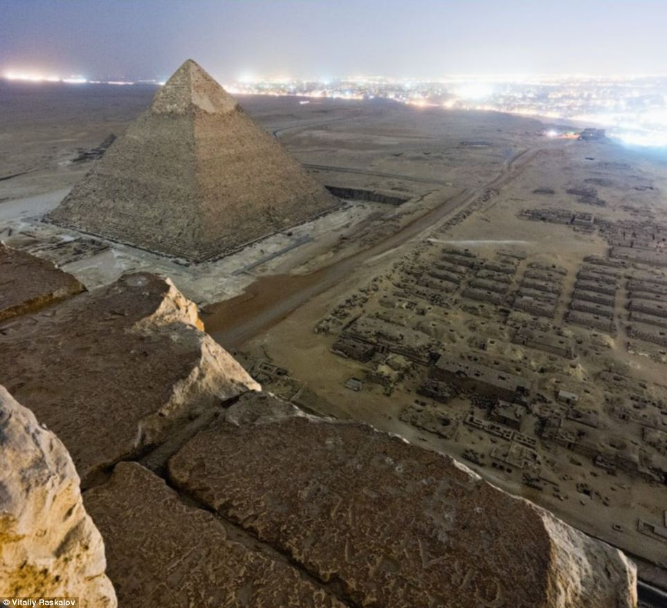 Vista: The Russians claim to have arrived early at the famous site on the outskirts of Cairo, where they waited in the shadows until official visitor opening hours were over to make their climb