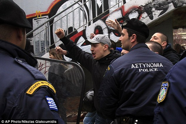Thessaloniki: A supporter of the ultra-nationalist party Golden Dawn shouts at protestors demonstrating against measures imposed on Cyprus