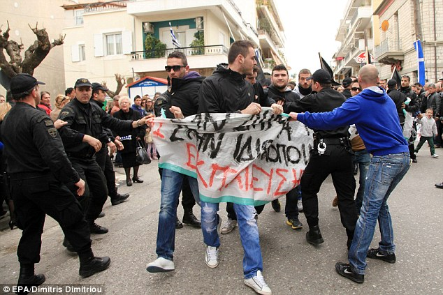 Anger: Protests were seen nationwide during Independence Day celebrations across Greece amid public anger at austerity measures