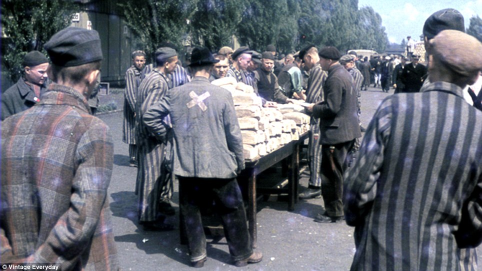 Rations: Bread is doled out among the prisoners