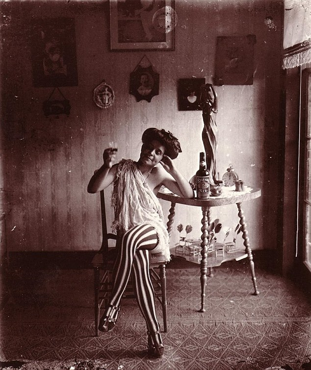 Haunting history: A series of intimate black and white photographs taken in 1912 by E.J. Bellocq reveal how prostitutes in New Orleans' red-light district of Storyville lived more than a century ago