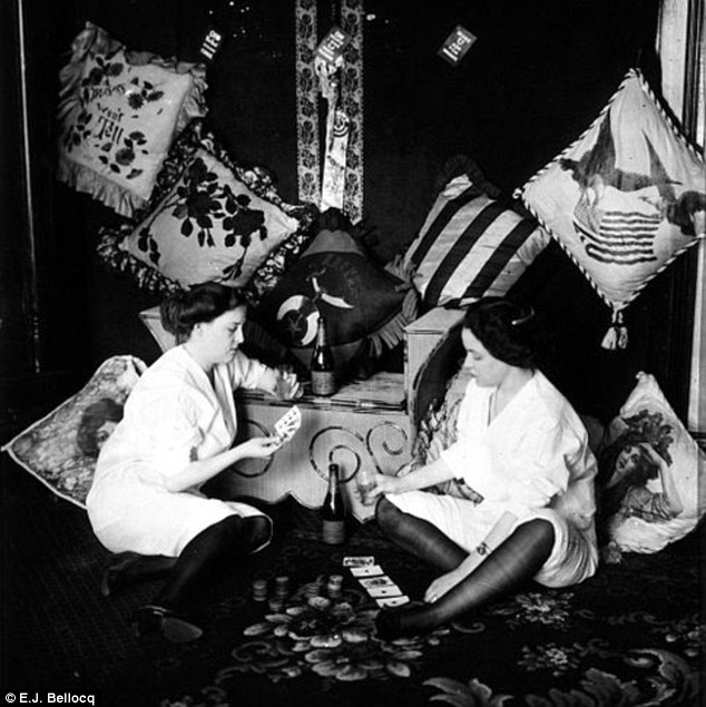 Poker players: Bellocq, who dies in 1949, took dozens of portraits inside the brothels of Storyville - the only legalized red-light district in North America, until it was shut down in 1917