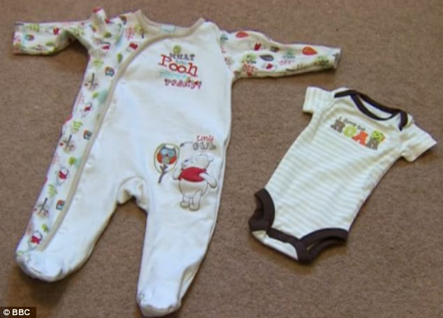 The newborn clothes his parents bought for him are much too small and he has to wear clothes meant for a six-month-old