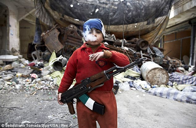 Children of war: The photo was taken in front of a barricade in the neighborhood of Salahadeen, Aleppo - the front lines of the bloody Syrian civil war