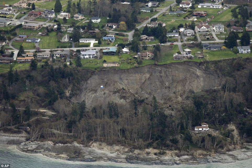 So close: Following the landslide, one house was destroyed, 16 were isolated and 17 others were threatened by further movement
