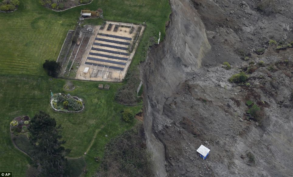 Fall: This aerial photo shows a garden area at the edge of a landslide near Coupeville, Washington, and how other structures are precariously close to the edge