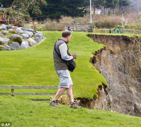 Geologist Terry Swanson from the University of Washington surveys the damage