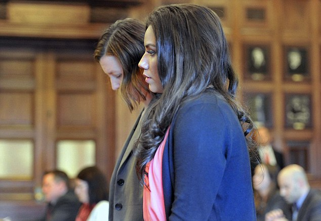 Admission of guilt: Zumba instructor Alexis Wright appears with her attorney, Sarah Churchill, to plead guilty to 20 counts, including prostitution, theft and tax evasion