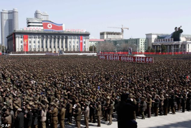 North Koreans gather at a rally at Kim Il Sung Square in downtown Pyongyang, North Korea