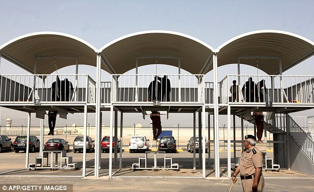 Sentenced to death: Three men hang from the scaffolding in Kuwait in the first executions in the country since 2007