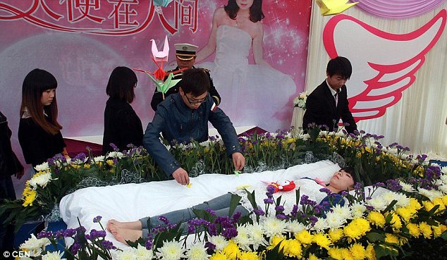 Paying tribute: Friends dutifully filed past the young woman's coffin as she lay there for an hour