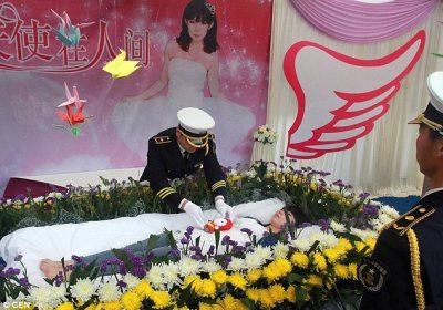 Coffin: Jeng Zia attended by men in military uniform as she lies in state at her own funeral