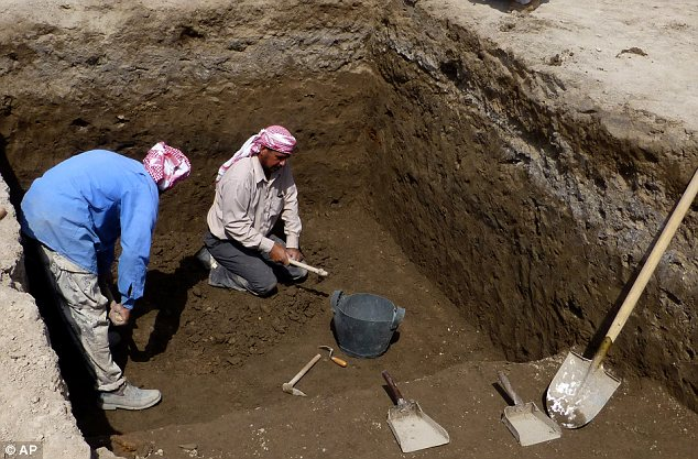 Dig: Archaeologists at work on a site in Iraq near the ancient city of Ur believed to be 4,000 years old